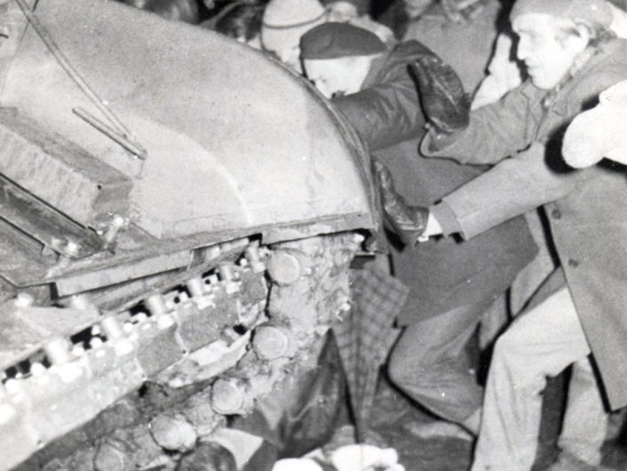 One of the legs under the tank belong to 23 year old Loreta Asaniviciute. In the hospital she asked the doctor if she will be able to marry. (The tank crushed her pelvis and she was referring to the ability to have children.) She died a few hours later. Her family buried her in a wedding dress.