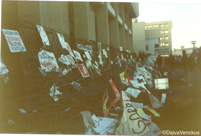 Chapter 19: Barricades and Barbed Wire Protecting the Parliament Building Covered With Anti-Soviet Protest Signs